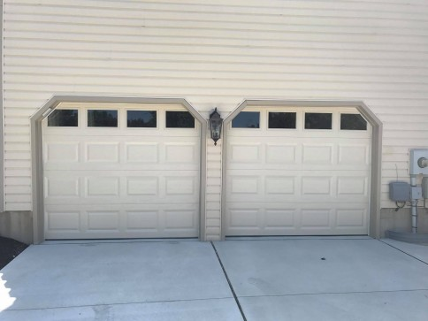 After - garage doors replaced with insulated garage doors with windows by Aviya's Garage Door.