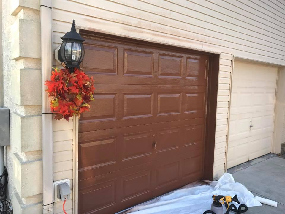 Customer wanted her new garage doors painted to match the trim color of her home. Aviya's Garage Door painted the doors in her preferred trim color.