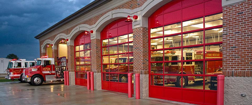 red fire house commercial garage doors. Commercial garage door repair & installation by Aviya's Garage Door company.